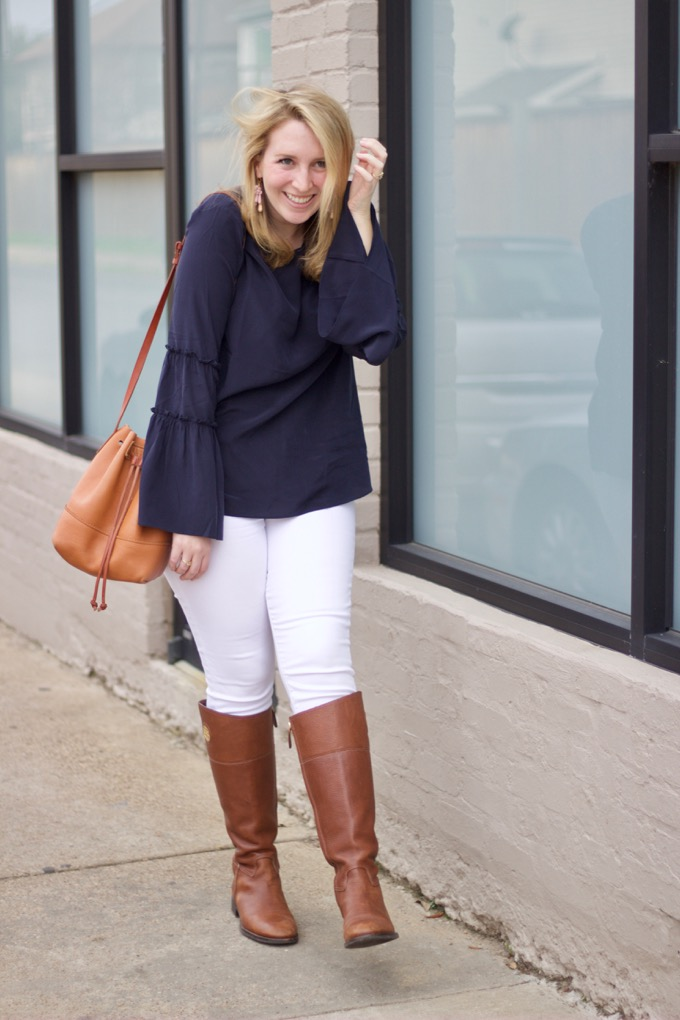 White jeans and riding boots for winter