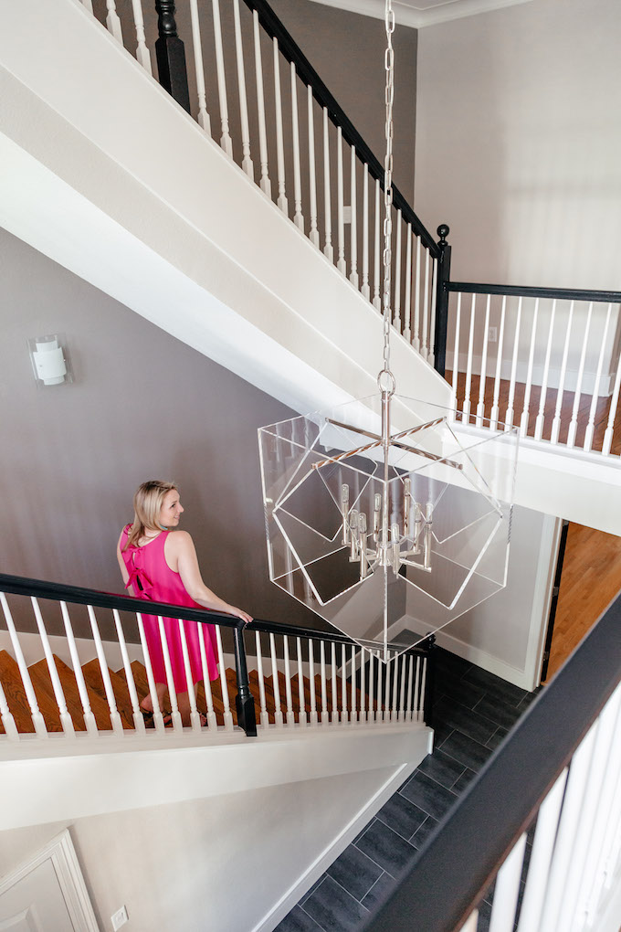 Lucite chandelier for entryway, how to style a townhouse entryway, hot pink bow-back dress