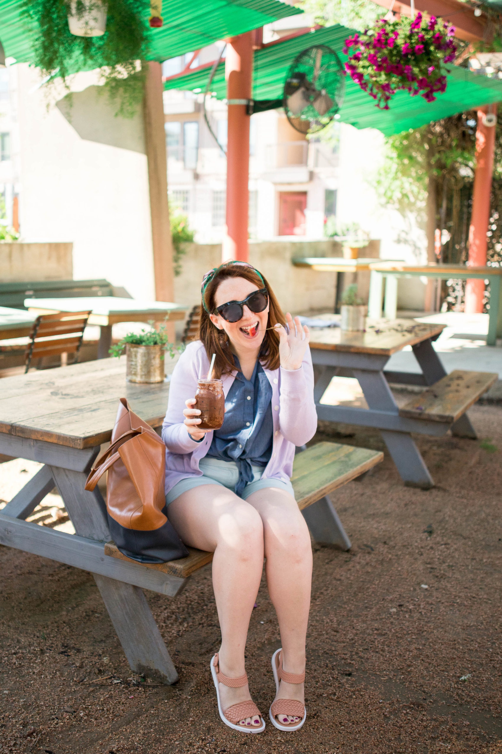 Blogger Amanda Kushner of Glitter & Spice wears shorts and chambray button down while drinking coffee | What I eat in a week on Faster Way to Fat Loss #FWTFL #ootd #springstyle #spring