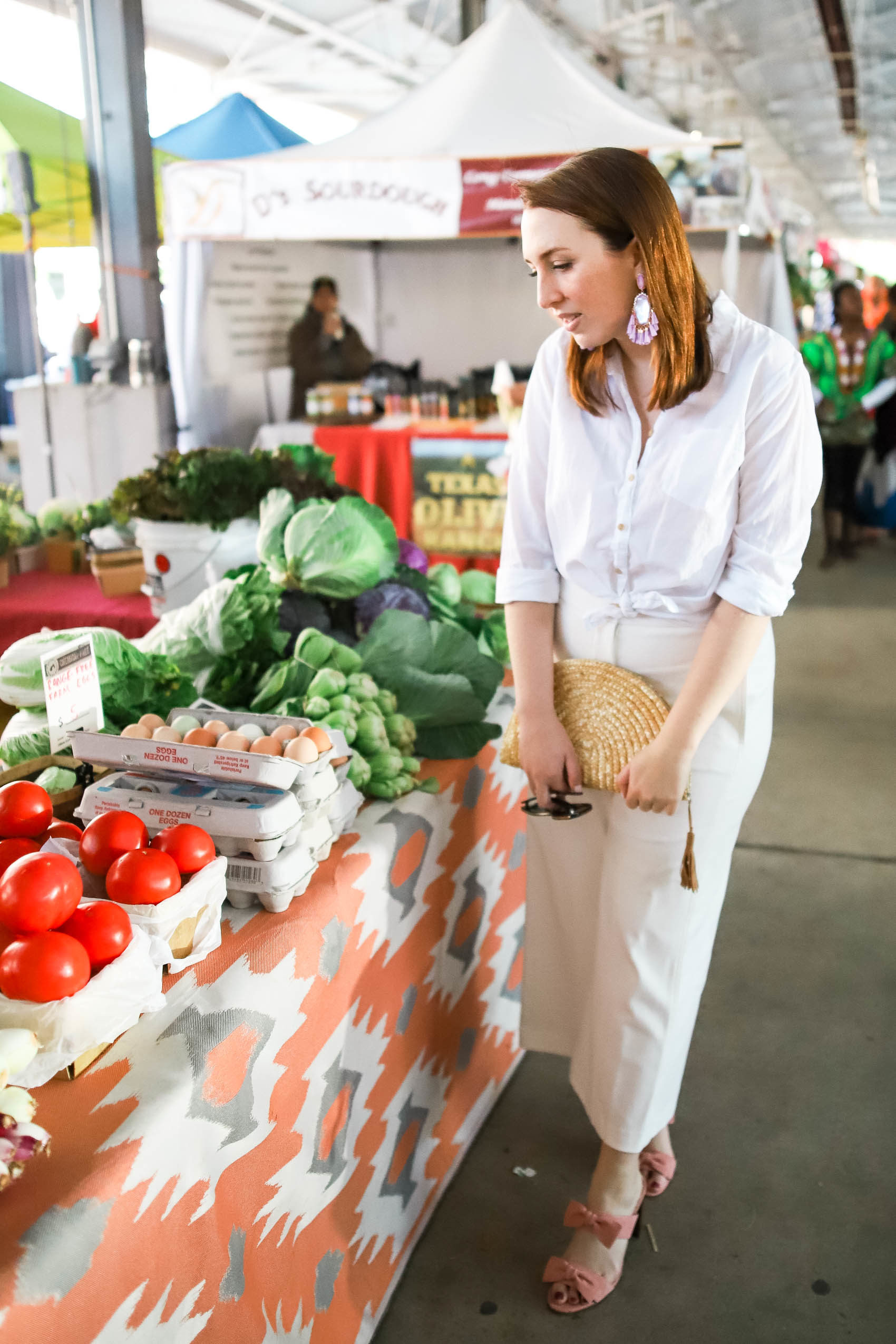 Blogger in all white at Dallas Farmers Market, showcasing how to play tourist in your own city | Staycation activity ideas in Dallas via Glitter & Spice #Dallas #outfit #summer