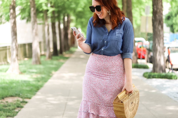 Daily look: floral midi skirt, chambray shirt, flower statement earrings, bamboo clutch, pink sandals | Dallas bloggers | Casual style | Summer outfit inspo | Spring outfit inspiration | Summer workwear look | Colorful work outfit | Fashion blogger photography | Fourth of July Outfit | Preppy Style | Feminine Outfit #womensfashion #summerstyle #fourthofjuly #outfitideas #summersales #fourthofjulyoutfits #fashion #style #workwear