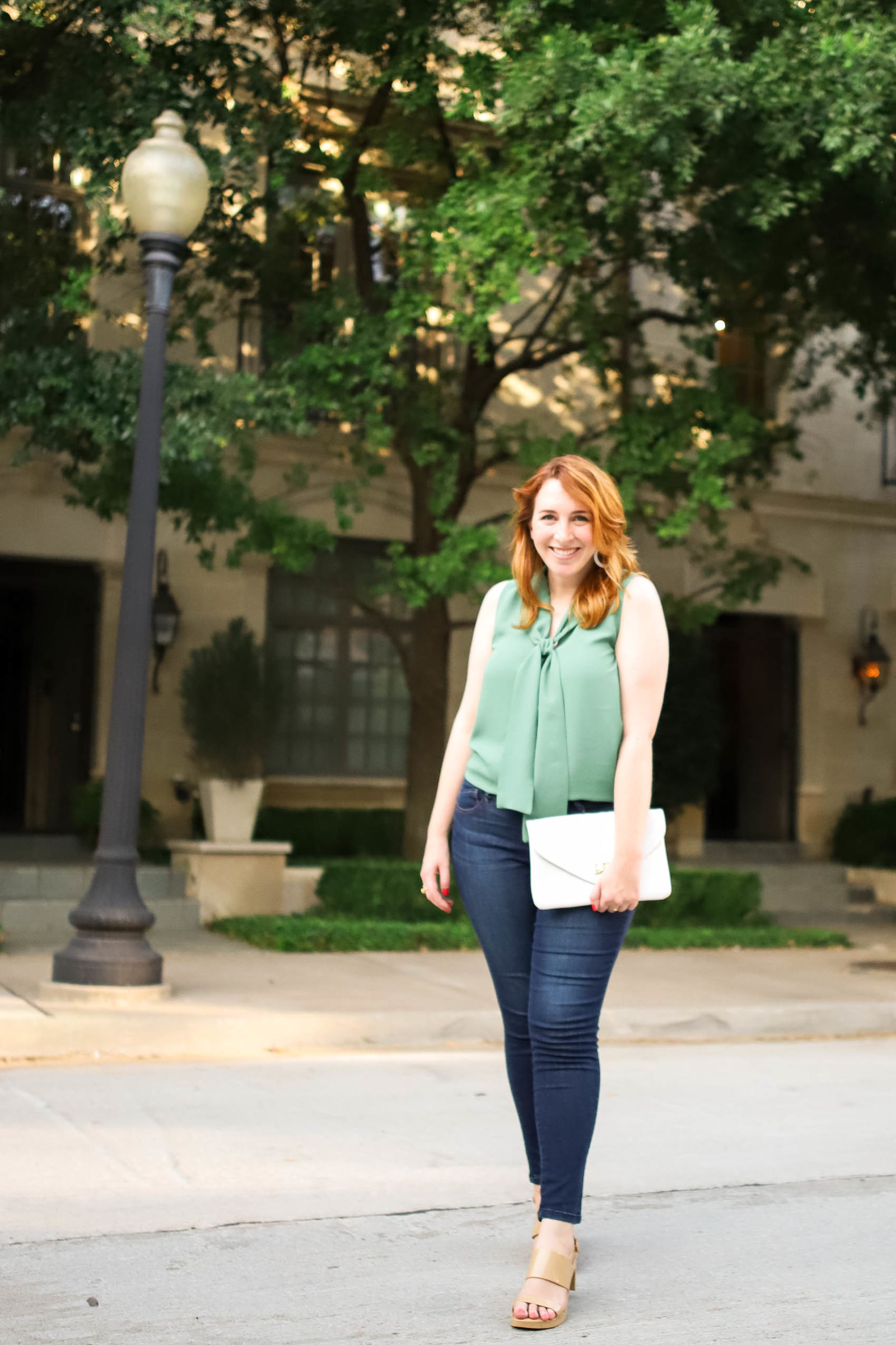 Blogger styles an outfit for a weeknight date with jeans and heels as she shares how she unwinds each day after her 9-to-5 job