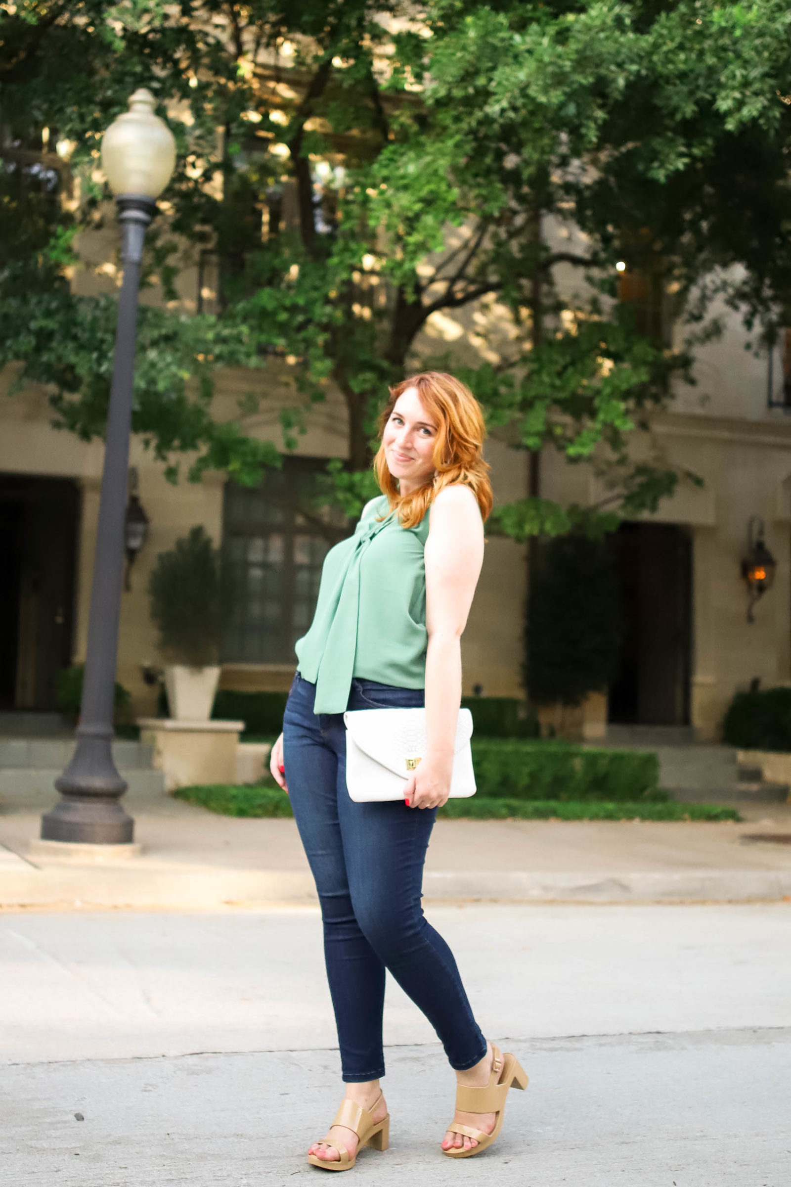 Blogger styles silk blouse and jeans as she shares her best everyday self care tips
