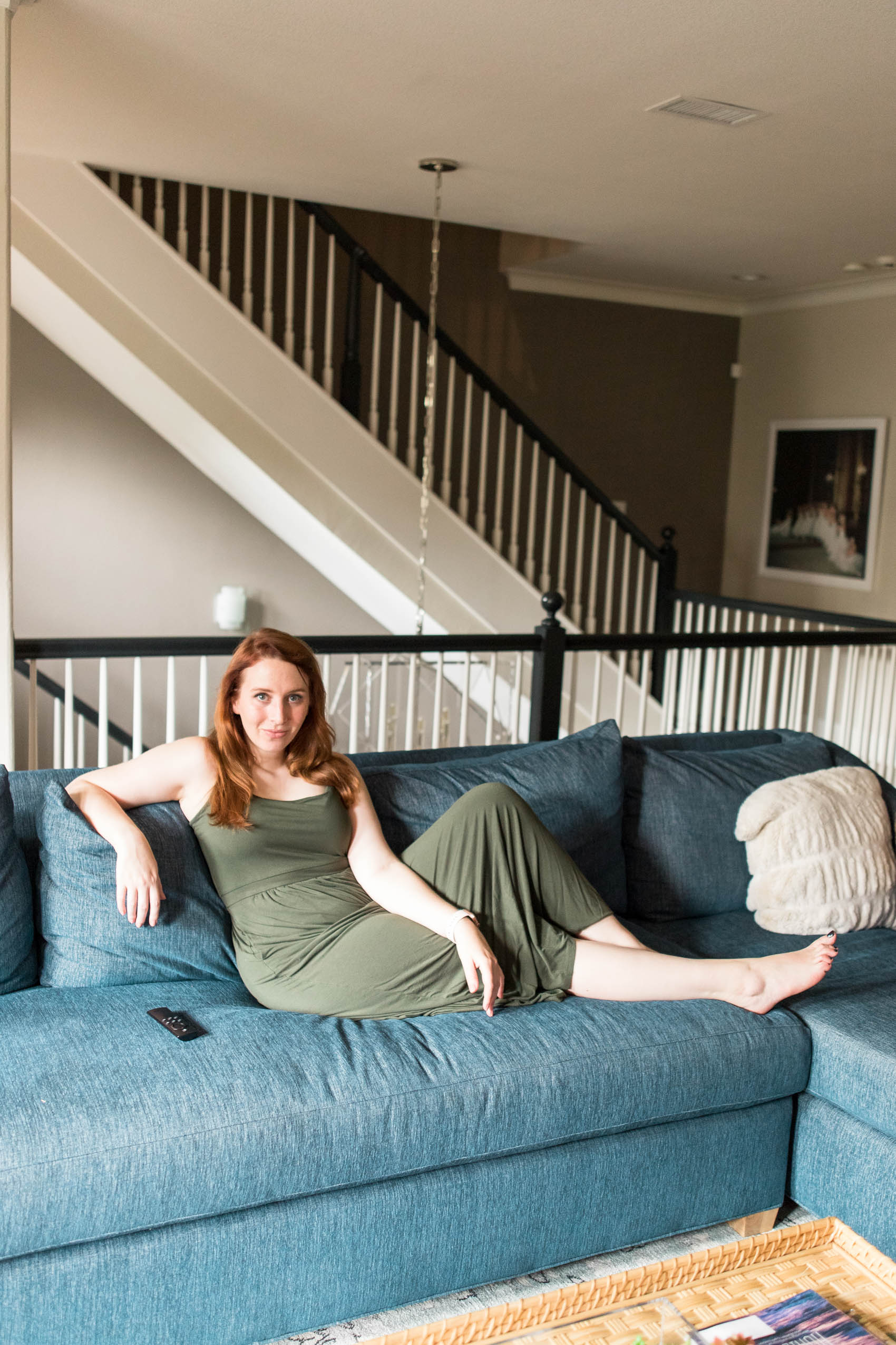 Blogger on denim couch sharing what to watch on Netflix while wearing loungewear dress