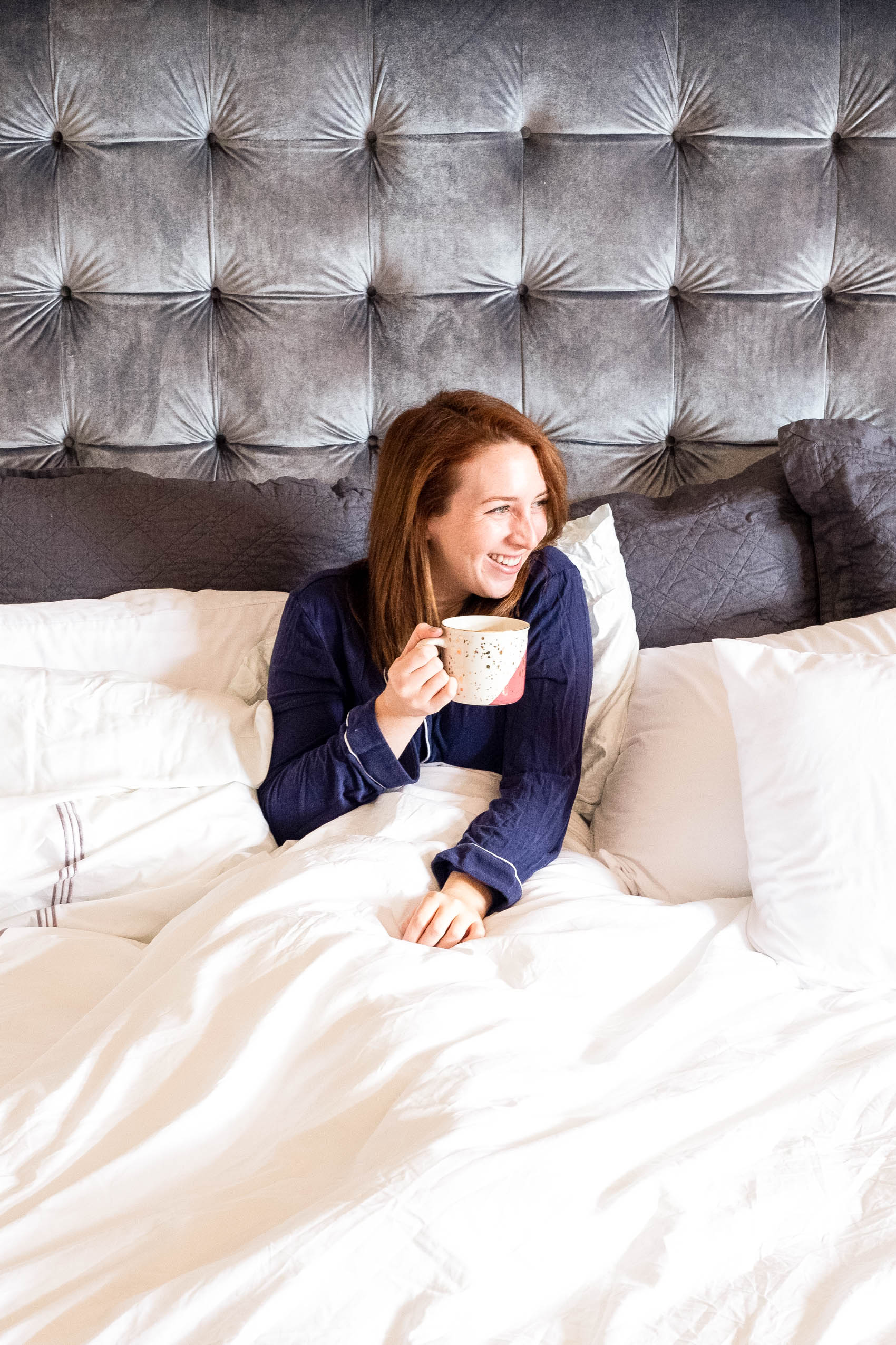 Sitting on a bed with a cup of coffee