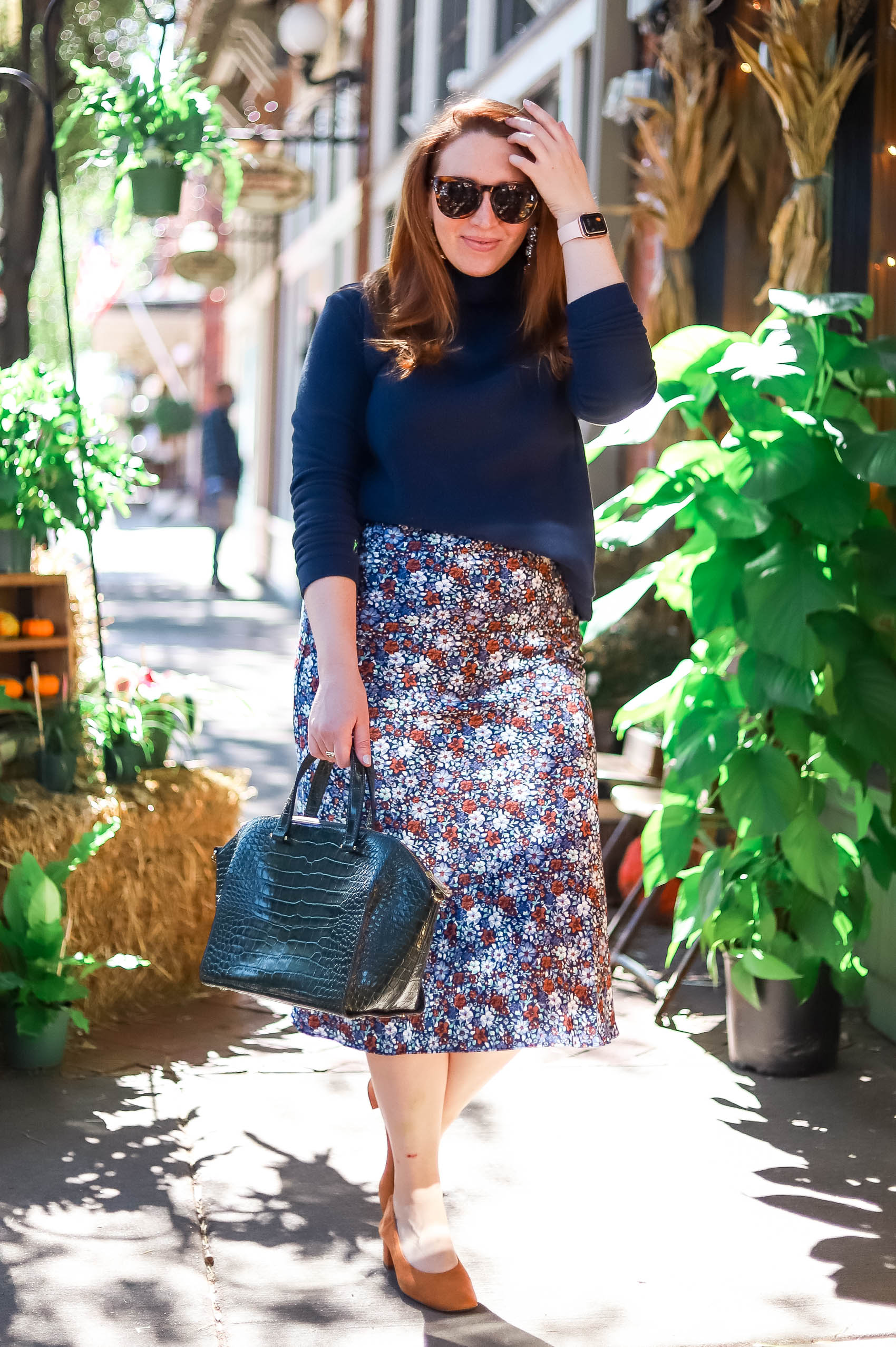 How to style a Dudley Stephens fleece turtleneck with a midi floral skirt