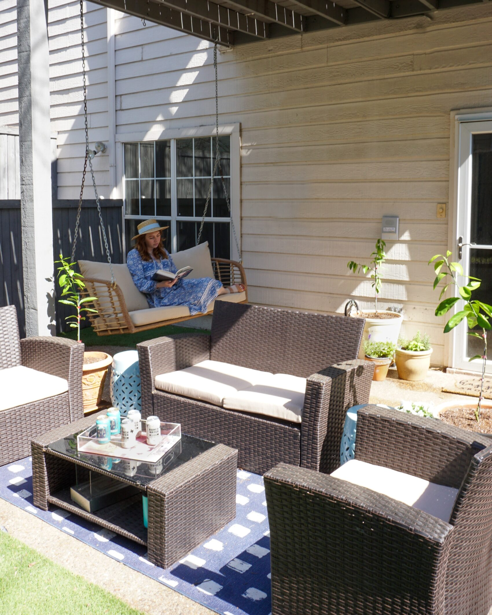 Blogger shares outdoor living space reveal as she redid her backyard entertaining area, turning her backyard into a plant-filled outside living room.